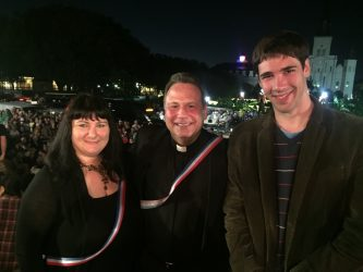 French Quarter Fest Executive Director Marci Schramm, Fr. Phillip Landy, and French organist intern Pierre Queval