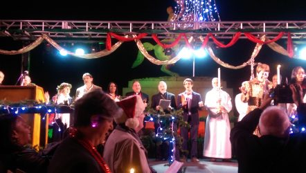 Archbishop Aymond and Fr. Philip Landry were among those carolling on stage.