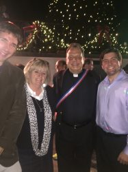 French organist intern Pierre Queval, Director of Operations Maureen Scheuermann, Fr. Phillip Landry, and Business and Communications Coordinator Ryan Saucier in front of the French Market Christmas Tree